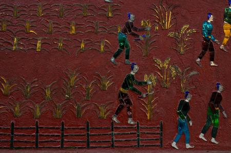 lao: mosaic on pink wall of Wat Xieng Thong buddhist temple in Luang Prabang Lao Stock Photo