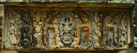 lintel: carving of monster on lintel of Banteay Samre Stock Photo