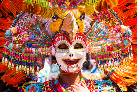 Masskara Festival performer wearing bird mask