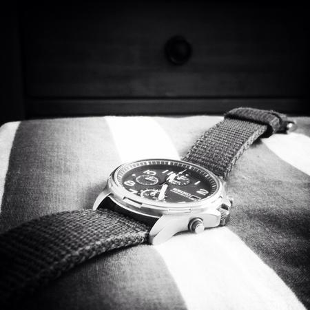 metallic: Time piece in black and white. Wristwatch Stock Photo