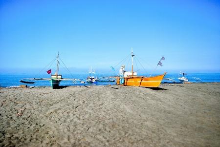 fishingboat: Fishermen at the shore.