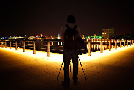 urbanscape: An amatuer photographer setting up his gear for a night photography.