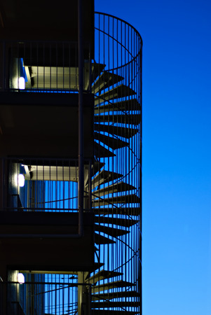 青の時間で螺旋階段 写真素材