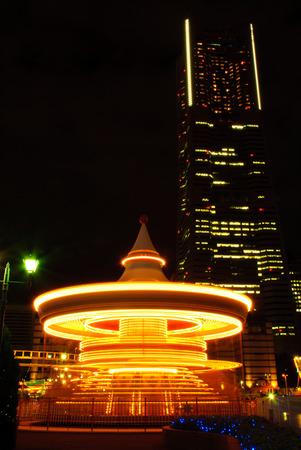 urbanscape: Carousel at night in long exposure. Yokohama, Japan at night. Stock Photo