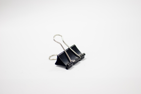binder clip: Binder clip in white background.