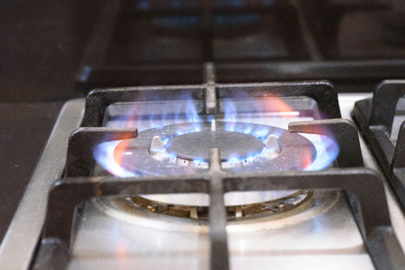 blue flame: LPG blue flame burning at the stove. Stock Photo
