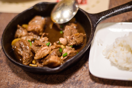 pinoy: Yummy adobo with rice.