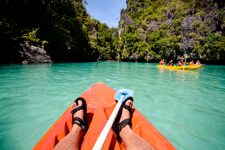 exploring the small lagoon of el nido in kayak stock photo picture