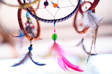 Colorful dream catcher displayed for sale.