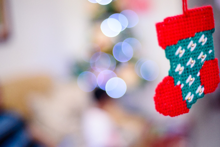 Red knitted sock for christmas decoration. Stock Photo