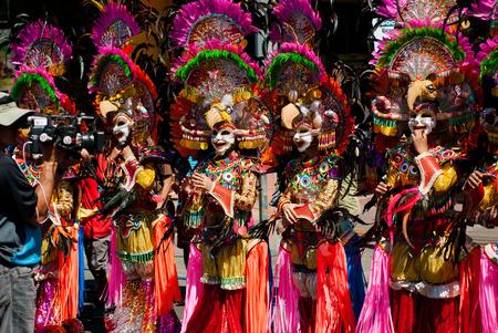 Masskara Festival street dance parade participant facing the video camera.