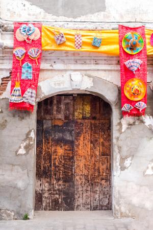 Vintage door along Calle Crisologo, Vigan, Ilocos Sur, Philippines.