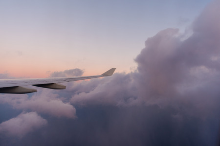 Window seat flying high above the clouds. Stok Fotoğraf
