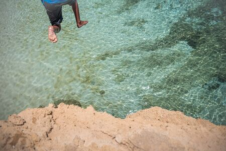 Taking a plunge at the white sand in the clear blue water.