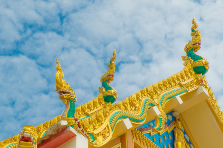 snakes and ladders: thai temple roof with king of nagas decoration