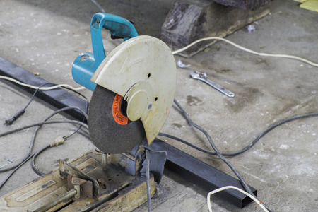 cut off saw: Cut-off Machine in Construction Site Stock Photo