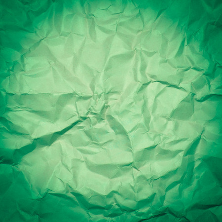 Green wrinkled paper, used as background texture Stock Photo