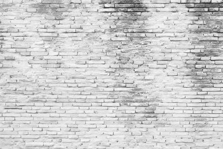 Cracked white grunge brick wall background