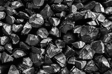blackwhite: Black-white background of dry chopped firewood Stock Photo