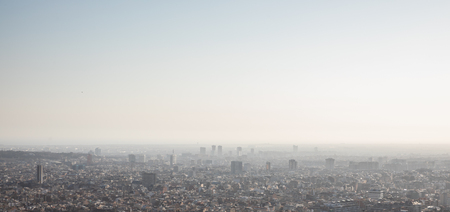 Foggy views of the city of Barcelona and the Mediterranean sea with copy space