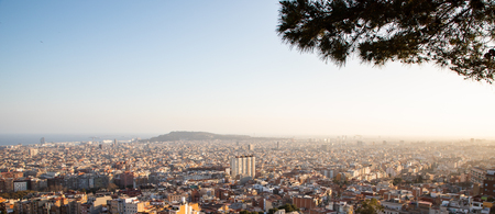 Views of the city of Barcelona and the Mediterranean sea during sunset with copy space