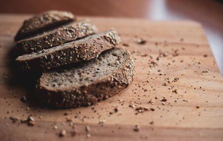 Sliced multigrain homemade bread on a wooden cutting board