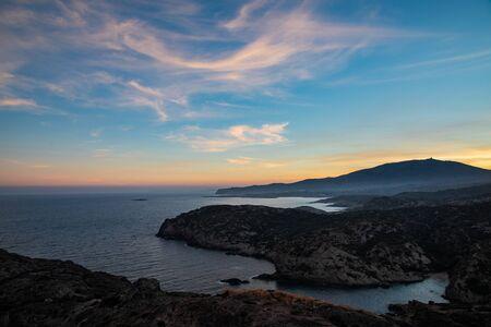 View of the coastline with sunset sky colors in Cap de Creus, Catalunya