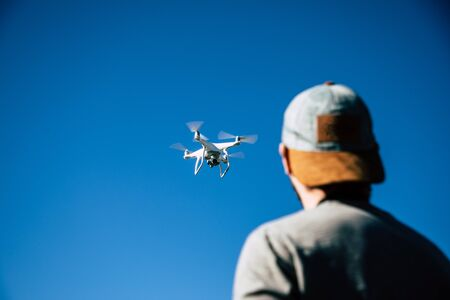 Man playing with drone on the open field