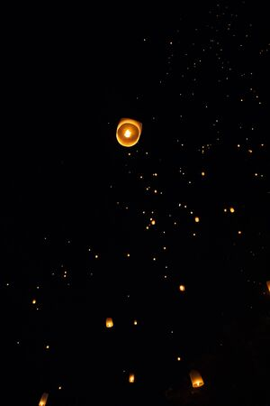 Loi Krathong and Yi Peng released paper lanterns on the sky during night