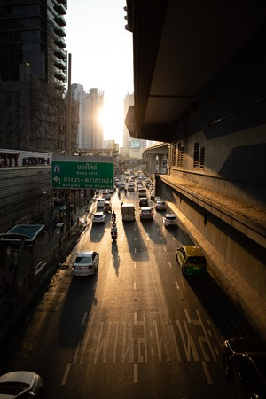 November 19th, 2018 - Bangkok (THAILAND) - Road with cars view from bridge with skyscrapers and sunset in foreground in Bangkok Editorial