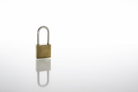 Locked padlock as security or privacy concept, isolated on white background with reflex and copy space