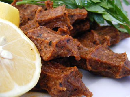 Turkish dumplings in spicy and lemon plate Stock Photo