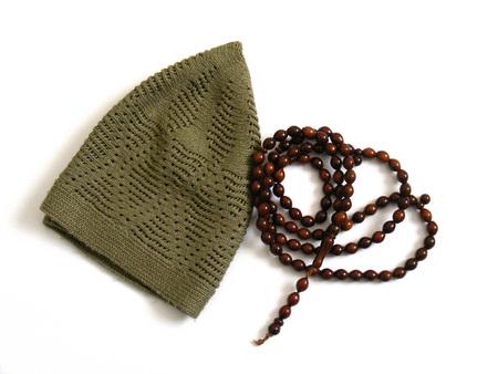 skullcap: Islam in a skullcap and prayer beads pictures
