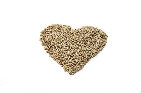 sunflower seeds in a heart-shaped picture Stock Photo