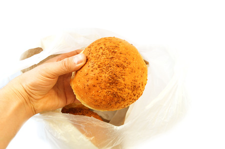 hand in a bag of bread field Stock Photo