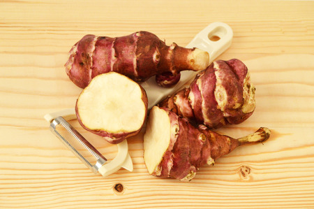 inulin: knife and sweet potato, Jerusalem, pictures Stock Photo