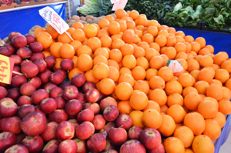 Apples and oranges sold in grocery aisles