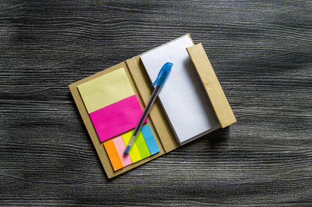 Pencil and note pad for note taking, sticky colored papers, colored sticky paper for taking notes, business man and notepad, business man and organizer, Stock Photo