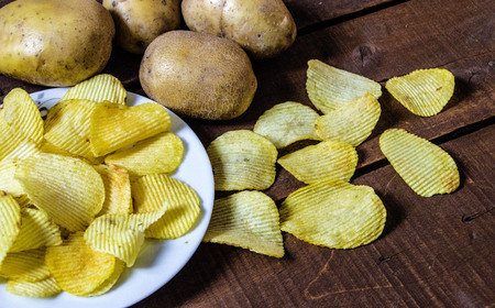 Potato and potato products, fried potato slices, serrated fried potato slices, fried potato chips Stock Photo