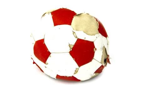 Old red white soccer ball