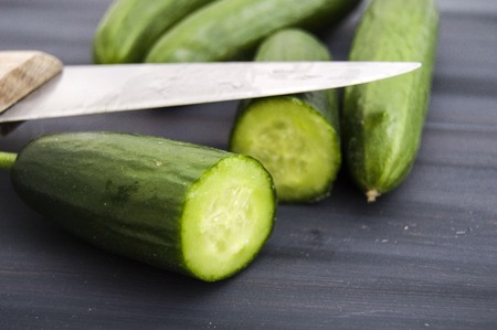 Cucumber, organic natural sailor cucumber pictures, cutting a cucumber with a knife, cucumber pictures on different topics Stock Photo