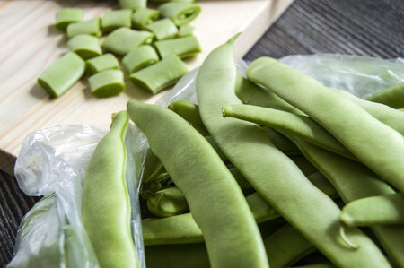 Fresh green beans ready to eat, green bean with knife,
