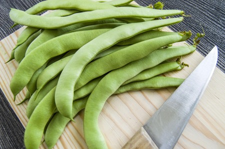 rejected: Fresh green beans ready to eat, green bean with knife,