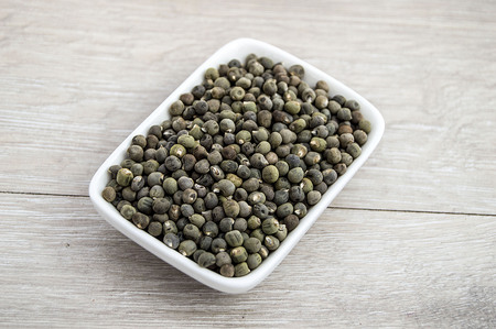 A bowl of okra seeds Stock Photo
