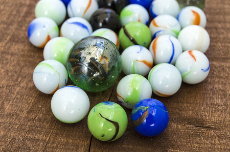 Childrens games, playing marbles, various colored marble paintings,