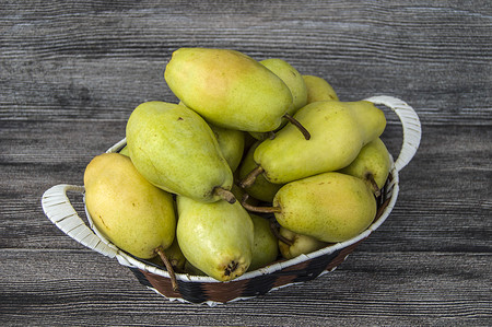 ripe pears in a basket Stock Photo