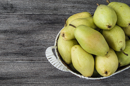 mature delicious pears in the plate