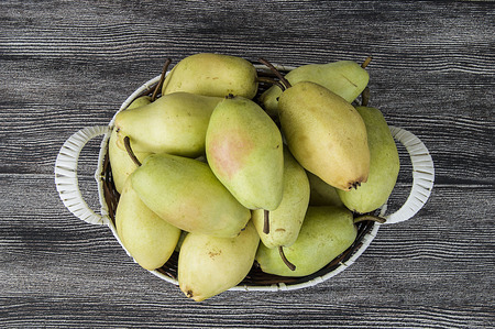 pitchfork: Mature pear pictures in the basket, natural and organic santa maria pear fruit pictures, Wonderful pear pictures in a fruit basket Stock Photo