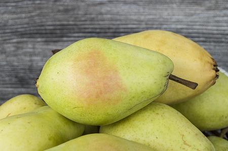 pitchfork: Summer fruit in a fruit basket, pear,