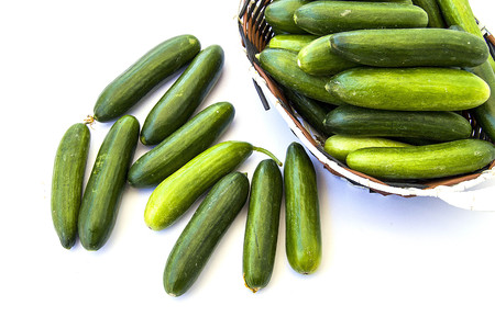 cucumber slice: Fresh cucumber pictures on a white background, natural and organic cucumbers, cucumber pictures cut with a knife in a basket